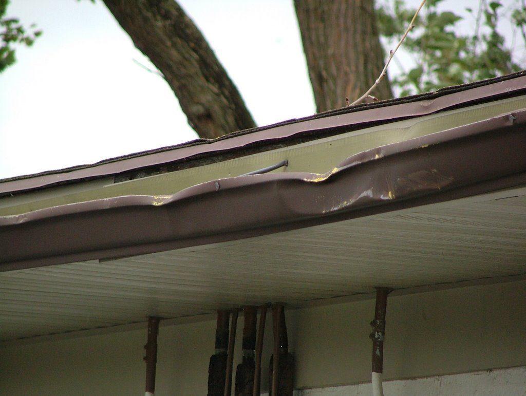 Gutter damage from big branch.